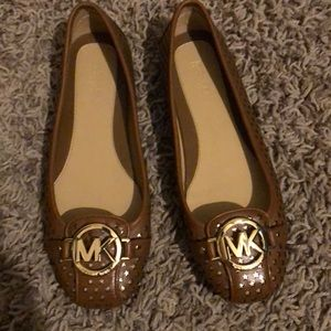 Brand new MK slip on shoes with cute detail